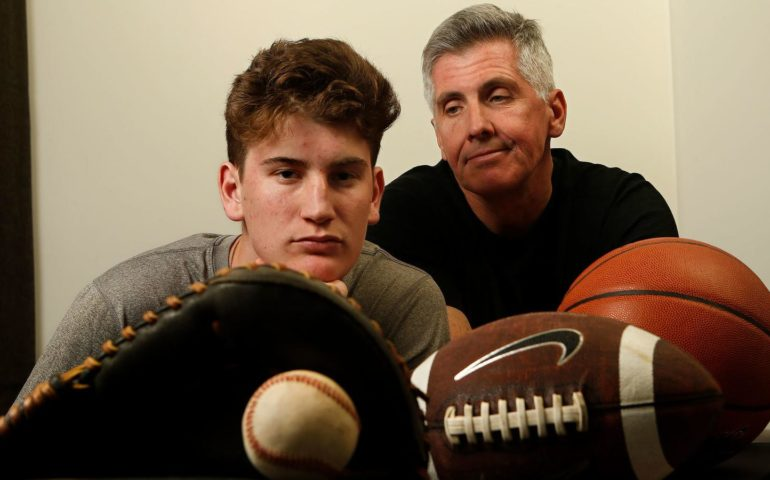 Aidan Cullen -- shown with his father, Mark -- was a three-sport athlete as a child but has since been diagnosed with a neurological disorder called Central Pain Syndrome. He still plays baseball at Windward. (Mel Melcon / Los Angeles Times)